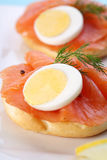 Smoked salmon on bagel with fresh black pepper. Royalty Free Stock Images