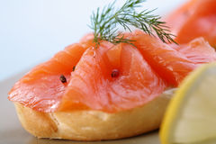 Smoked salmon on bagel with fresh black pepper. Stock Photography