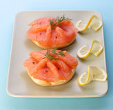 Smoked salmon on bagel with fresh black pepper. Royalty Free Stock Photo