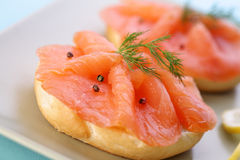 Smoked salmon on bagel with fresh black pepper. Stock Photo