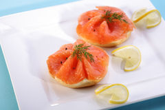 Smoked salmon on bagel with fresh black pepper. Royalty Free Stock Photography