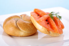 Smoked salmon on bagel with freshly black pepper. Stock Images
