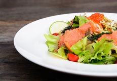 Smoked salmon balsamic vinegar salad Stock Photography