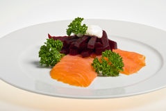 Smoked salmon with beetroot. Parsley and sour cream stock photography