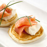 Smoked Salmon Blini. Blini topped with smoked salmon and sour cream stock photography