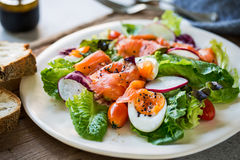 Smoked Salmon with boiled eggs salad. By some bread Stock Images