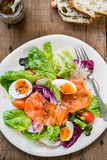 Smoked Salmon with boiled eggs salad. By some bread Royalty Free Stock Photography