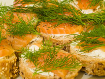Smoked salmon bread. Seafood - smoked salmon, cheese, and dill on bread Stock Photography
