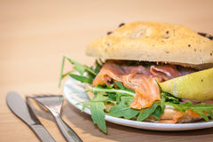 Smoked salmon bun close up Royalty Free Stock Images