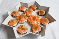 Smoked Salmon Canapes. Smoked salmon and cream cheese topped with dill on blinis & pumpernickel bread Stock Images