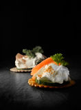 Smoked Salmon Canapes. Creatively lit smoked salmon canapes against a black background. Copy space Stock Photography