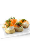 Smoked Salmon Canapes. Delicious soft cream cheese and smoked salmon canapes with dill against a white background. Copy space Stock Images