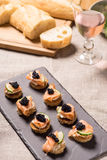 Smoked Salmon Canapes with Sour Cream and Caviar Royalty Free Stock Images
