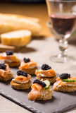 Smoked Salmon Canapes with Sour Cream and Caviar Stock Photography
