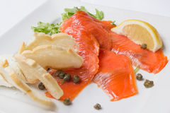 Smoked Salmon with Capers Closeup Stock Images
