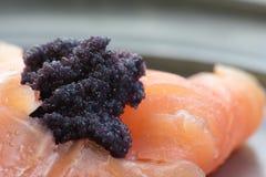 Smoked salmon and caviar. Royalty Free Stock Photo