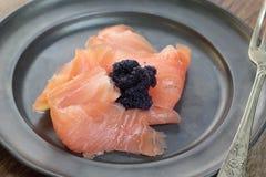 Smoked salmon and caviar. Stock Photo