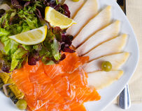 Smoked salmon and cheese platter Royalty Free Stock Photo
