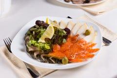 Smoked salmon and cheese with salad Stock Image