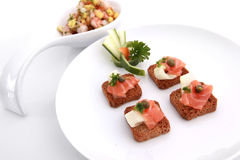 Smoked salmon crackers Stock Photography