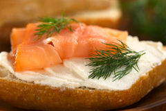 Smoked Salmon and Cream Cheese Canape. Canape of smoked salmon and cream cheese on wholewheat bun garnished with dill (Selective Focus, Focus on the front of the Stock Photos