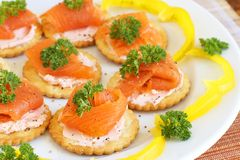 Smoked salmon and cream cheese on crackers royalty free stock images