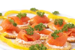 Smoked salmon and cream cheese on crackers Royalty Free Stock Image