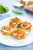Salmon crostini. Smoked salmon crostini with cheese,caper and dill Stock Photos