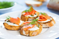 Salmon crostini. Smoked salmon crostini with cheese,caper and dill Royalty Free Stock Photography