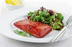 Smoked salmon filet with baby greens salad. Smoked salmon filet with fresh baby greens salad Royalty Free Stock Image