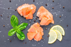 Smoked salmon filet with lemon and basil, top view, horizontal Stock Images