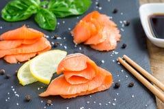 Smoked salmon filet with soy sauce, horizontal, closeup Stock Image