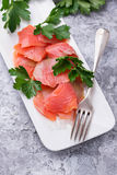 Smoked salmon fillet with parsley Stock Images