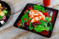 Smoked salmon fillet portion of fresh salad with aromatic herbs. Vegetables healthy food appetizing prepared seafood fish dinner meal lunch cuisine plate dish royalty free stock photo