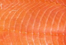Smoked salmon fillet texture. Orange smoked salmon fillet texture royalty free stock photos