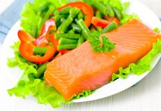 Smoked salmon fillet with vegetables Royalty Free Stock Images
