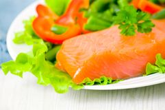 Smoked salmon fillet with vegetables Royalty Free Stock Photo