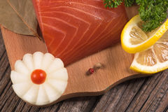 Smoked salmon fillet. With vegetables on the cutting board on the old wooden surface Royalty Free Stock Photography