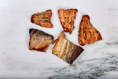 Smoked salmon fillets on marble stone countertop Stock Photo