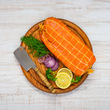 Smoked Salmon Fish with Small Meat Cleaver. Top View Of Red Smoked Salmon Fish with Lemon and Onion royalty free stock photo