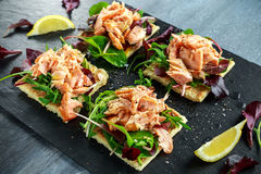 Smoked salmon flakes on salad bed and irish potato slims snacks, appetizers stock images