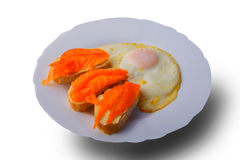 Smoked salmon with fried eggs. On the plate and white background stock photo