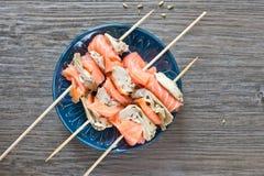 Smoked salmon and grilled artichoke Stock Photo
