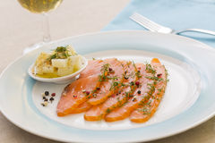Smoked  salmon and ingredients in plate on table Royalty Free Stock Photography