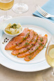 Smoked  salmon and ingredients in plate on table Stock Photo
