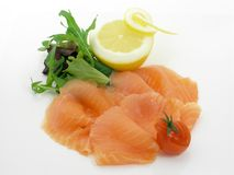 Smoked salmon with lemon Stock Images