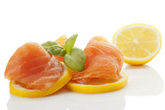 Smoked salmon with lemon. Stock Images