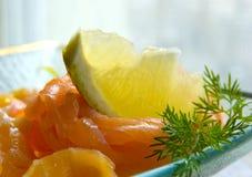 Smoked salmon with lemon Stock Photography