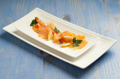 Smoked salmon with lemon and parsley Royalty Free Stock Photo