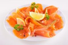 Smoked salmon and lemon Royalty Free Stock Photography